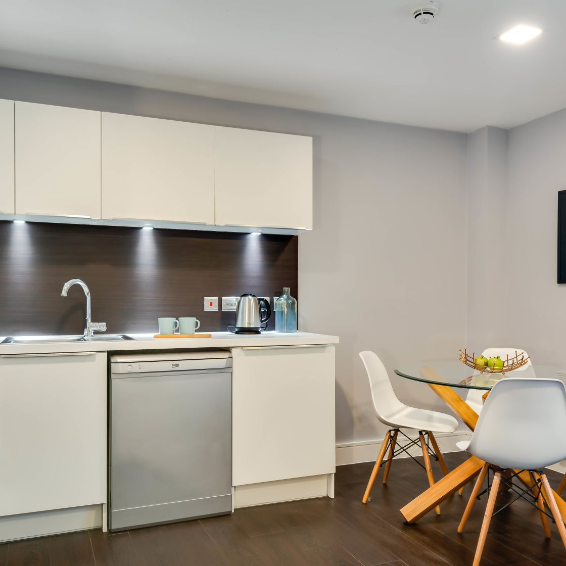 Grande Student Apartment in Leeds. Kitchen with dishwasher and dining table IconInc, The Edge,