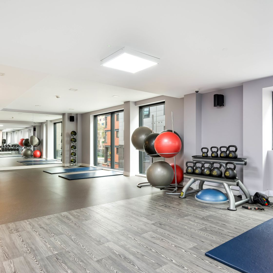 Gym with floor matts, exercise balls and large mirrors at IconInc, The Edge. Student Accommodation in Leeds