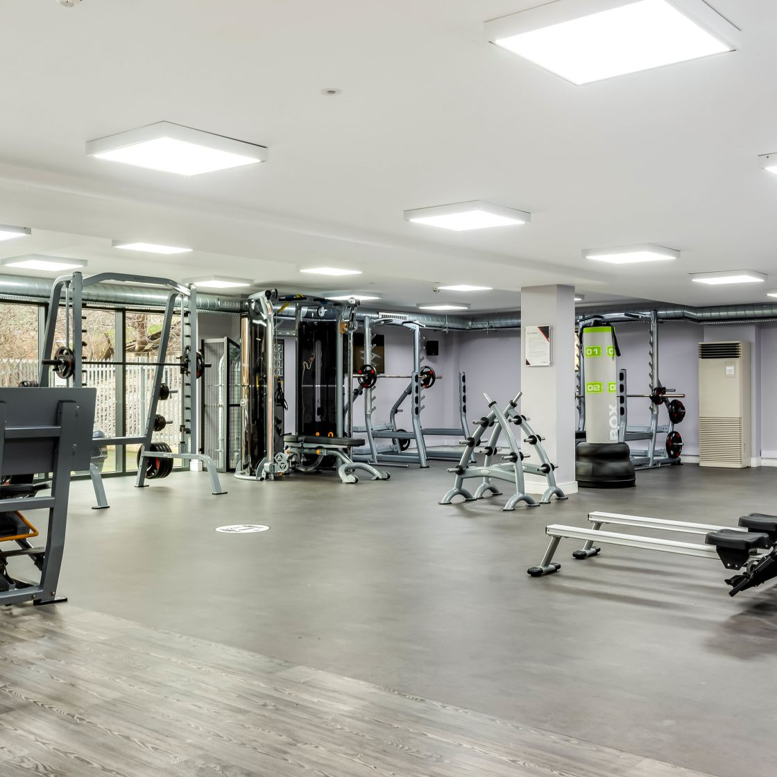 Gym with rowing machines and strength equipment at IconInc, The Edge. Student Accommodation in Leeds