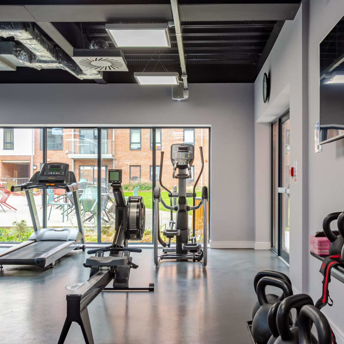 Gym with Cross Trainers, Kettle Bells and Treadmill at IconInc, The Glassworks. Student Accommodation in Leeds