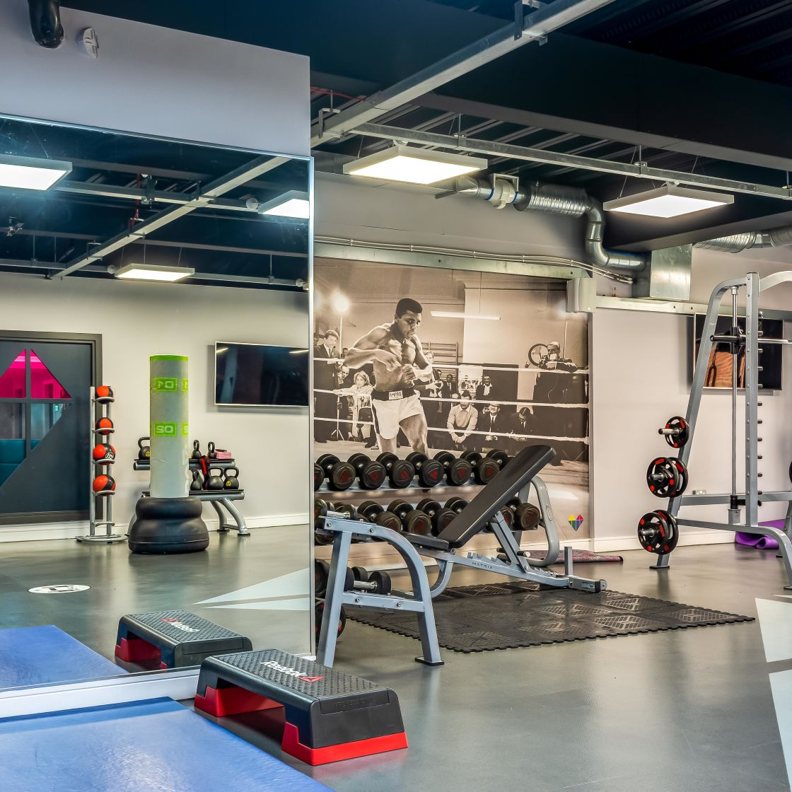 Gym with step block. Free Weights and Squat Rack at IconInc, The Glassworks