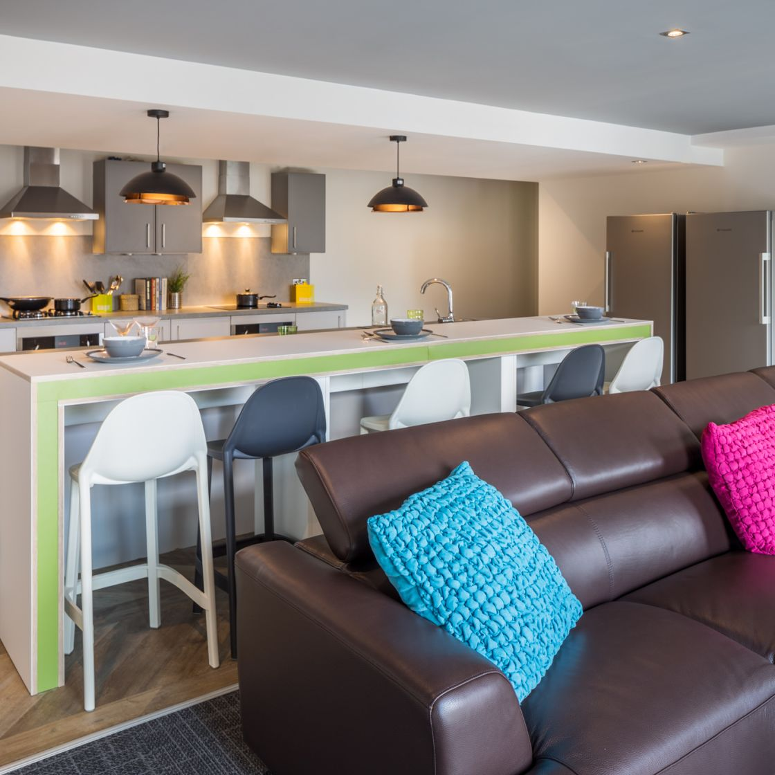 Communal kitchen with breakfast and sofa area at IconInc, The Glassworks. Student Accommodation in Leeds