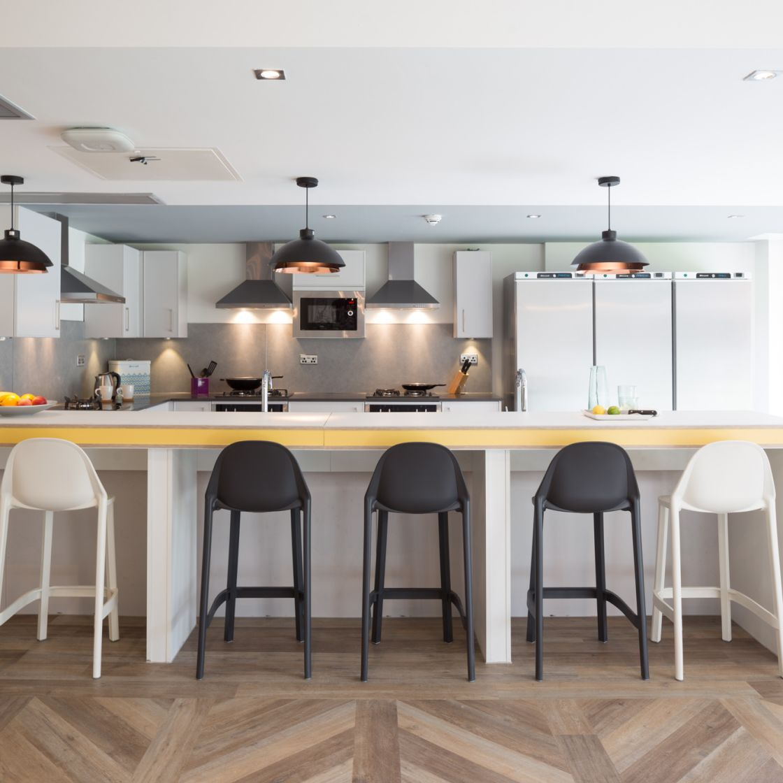 Mega Kitchen with breakfast bar and seating at IconInc, The Glassworks. Student Accommodation in Leeds