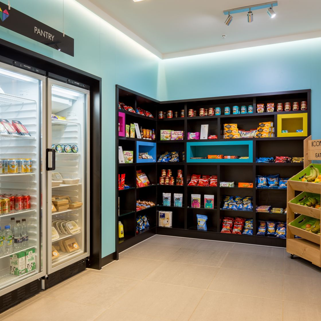 Pantry with shelved and refrigerated goods at IconInc, The Ascent. Student Accommodation in Liverpool