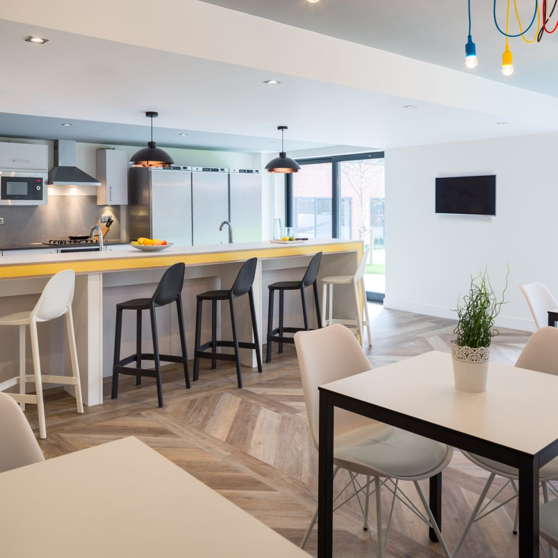 Mega Kitchen with Dining Tables and chairs at IconInc, The Glassworks. Student Accommodation in Leeds