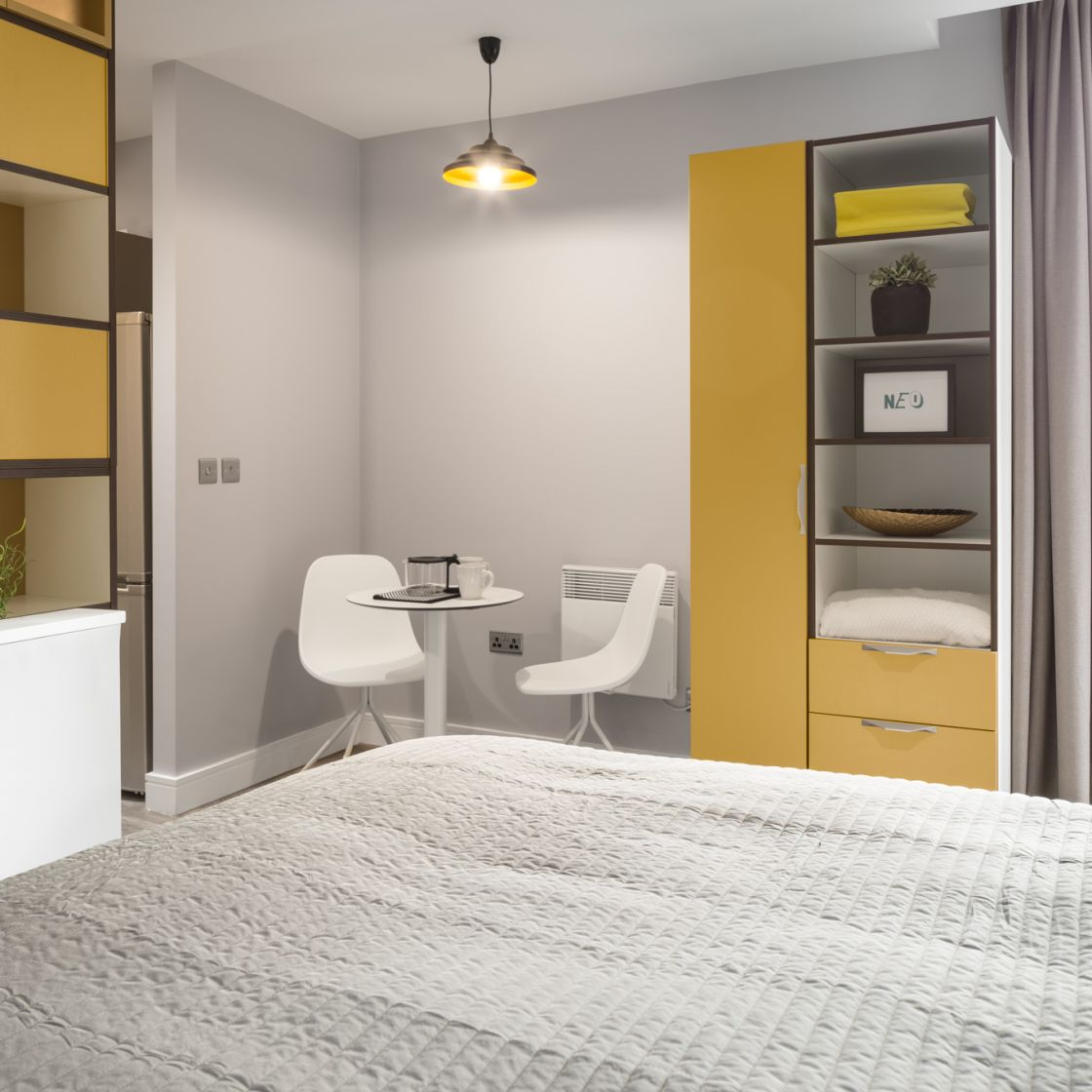 Grande Student Apartment in Liverpool. Double Bed, TV and dining table IconInc, The Ascent
