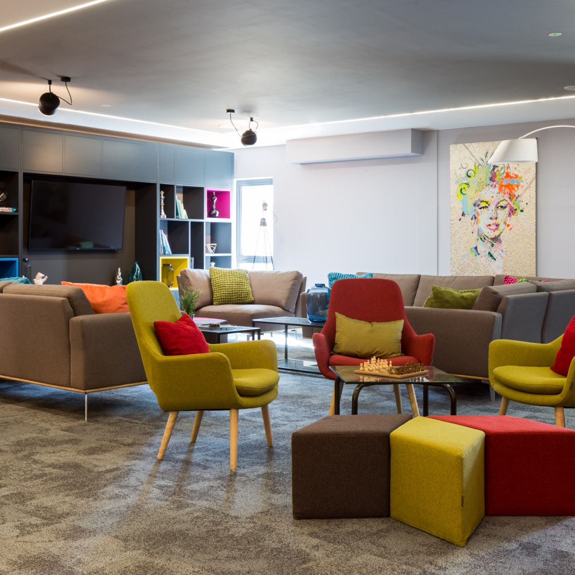 Reception lounge with seating, TV and games consoles at IconInc, The Glassworks. Student Accommodation in Leeds