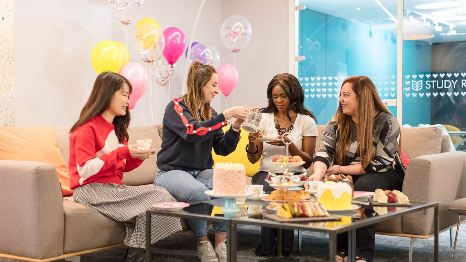Students having a tea party at IconInc. Student Accommodation in Leeds