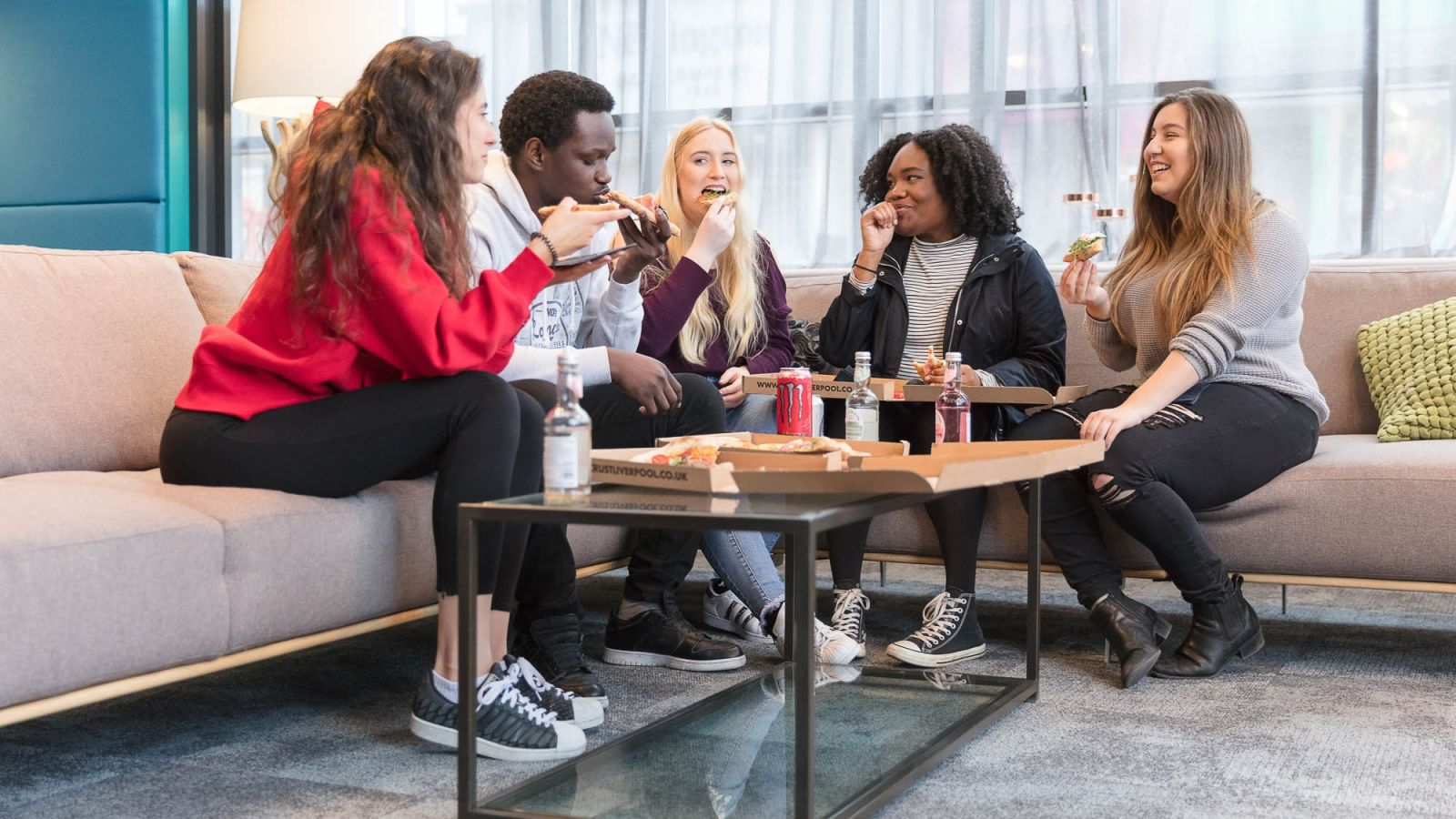 Students Eating Pizza in IconInc Mega Lounge. Student Accommodation in London
