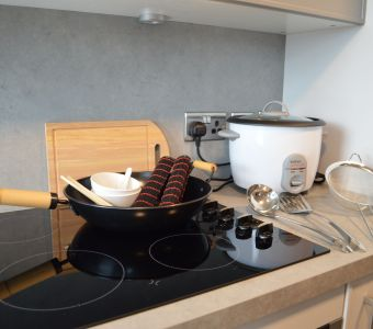 Fusion cooking with with Wok, Chop sticks, Utensils and Rice Cooker