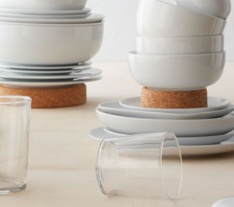 Essential tableware with crockery and glasses