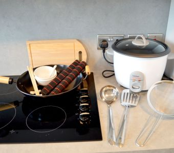 Fusion kit with wok, chopsticks, utensils and Rice Cooker. IconInc @ Roomzzz Leeds City West