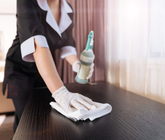 Housekeeper cleaning. IconInc @ Roomzzz. Student Accommodation in Manchester