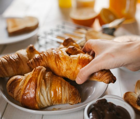 Breakfast spread with pastries, juice and fresh bread. IconInc, Triangle. Student Accommodation in Leeds
