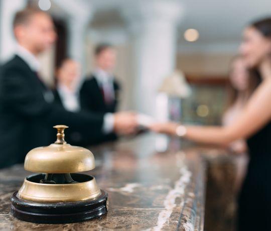 Concierge behind 24 Hour reception desk