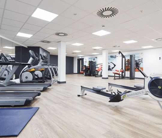 On site gym with strength and cardio equipment at IconInc @ Roomzzz Manchester Corn Exchange