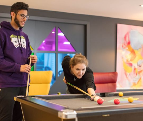 Students playing Pool at IconInc, The Edge. Student Accommodation in Leeds
