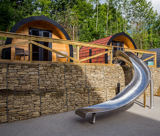 Wooden Glamping Pods and Slide at IconInc, The Glassworks. Student Accommodation in Leeds