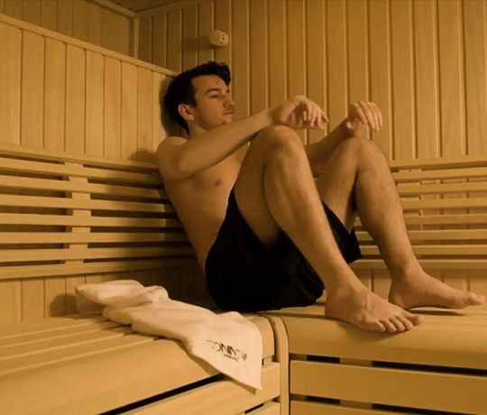 Student in the Sauna at IconInc, The Glassworks. Student Accommodation in Leeds