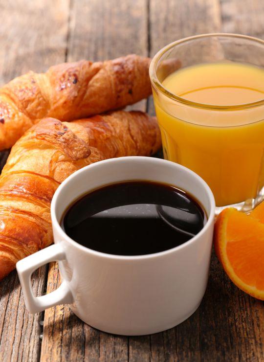 Breakfast spread of coffee, juice and pasties. IconInc @ Roomzzz Leeds City West