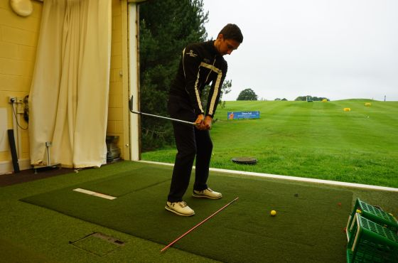 PGA trainee professional, Nathan, demonstrating a golf drill for swing plane accuracy.