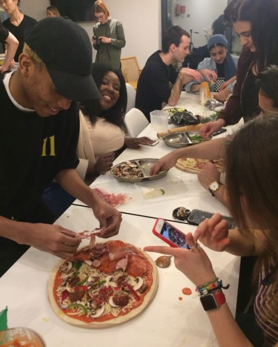 IconInc students topping their pizzas