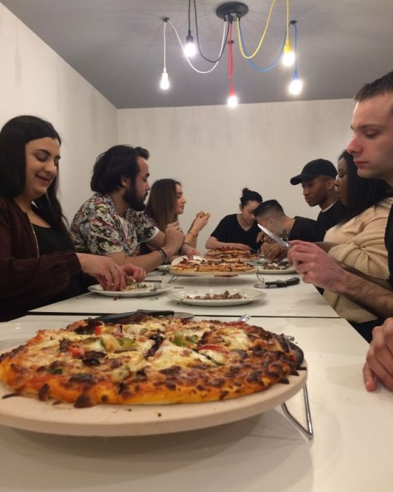 Students eating their pizzas, made with the help of Chris Hale