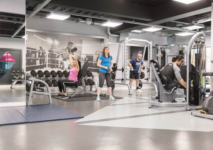 IconInc residents working out in the on-site gym.