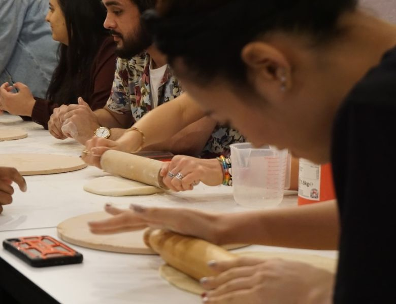 IconInc students making pizza dough with Chris Hale