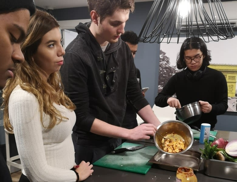 Students learning to cook in the mega kitchen