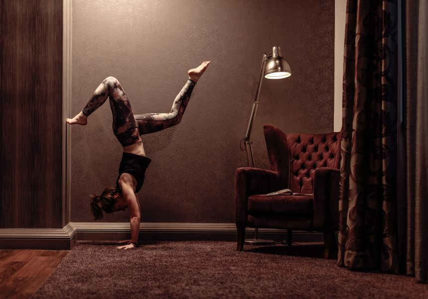 Woman doing yoga in her apartment. Student Accommodation in London