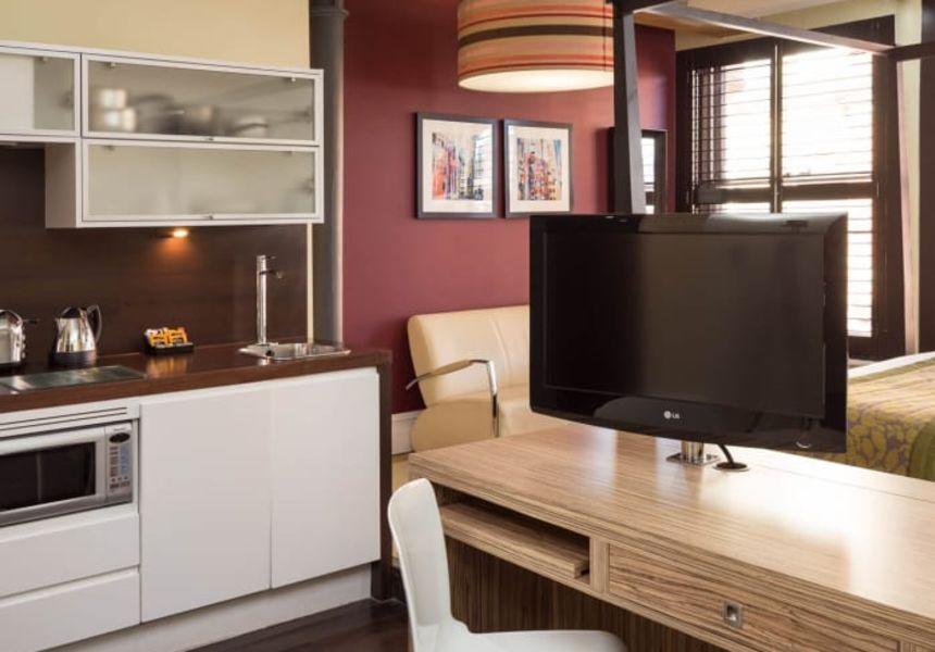 Grande Studio Student Apartment in Manchester. Kitchen, Desk and TV. IconInc @ Roomzzz