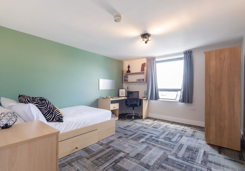 Premium Student Apartment in Leeds with double bed, desk and chair. Student Accommodation in Leeds