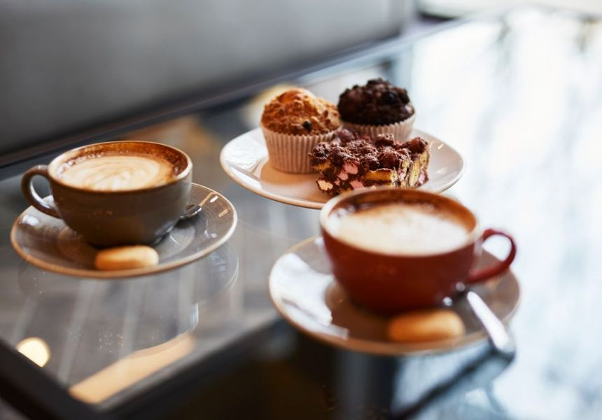 Fresh Coffee in cup and saucer. Freshly baked cakes.