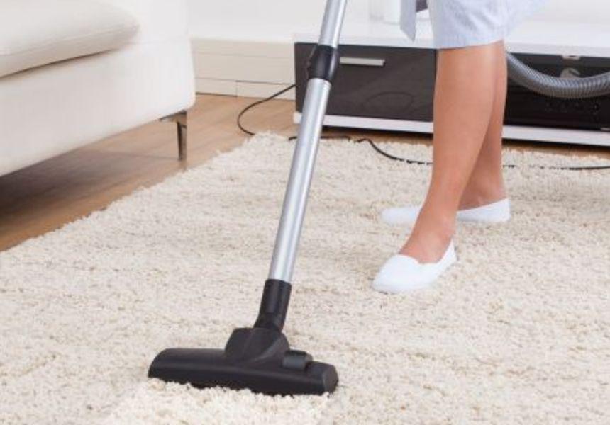 Housekeeper hoovering. IconInc @ Roomzzz