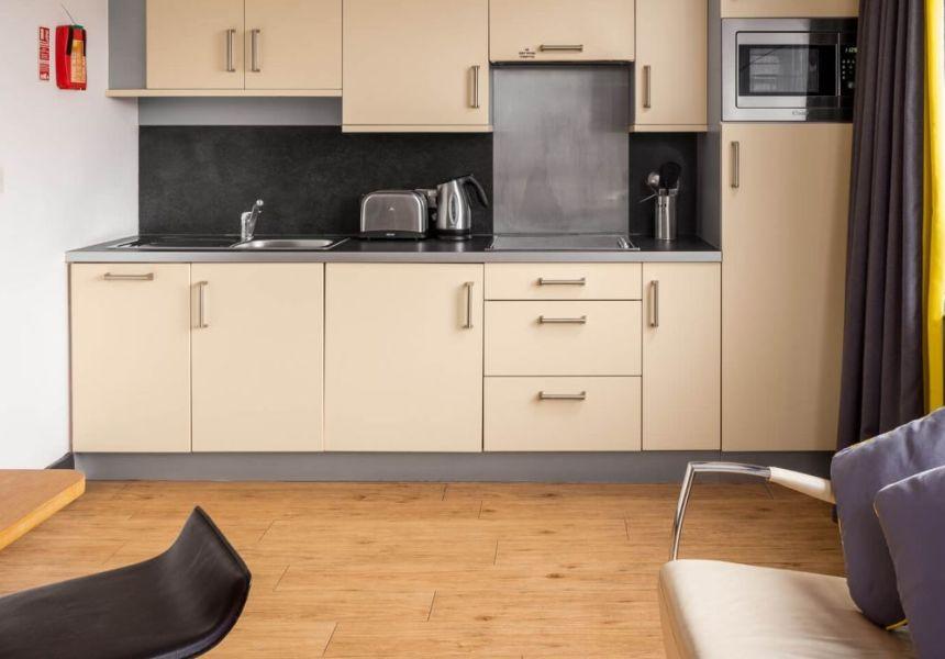 Smart studio student apartment in Leeds. Kitchen with dishwasher. IconInc @ Roomzzz Leeds City West