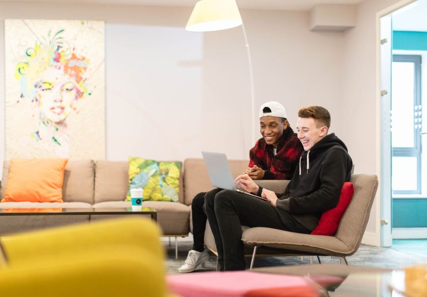 Students relaxing in the Lounge at IconInc, The Glassworks. Student Accommodation in Leeds