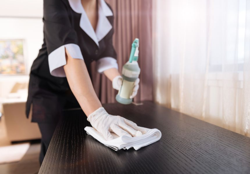 Housekeeper carrying out cleaning task at IconInc @ Roomzzz