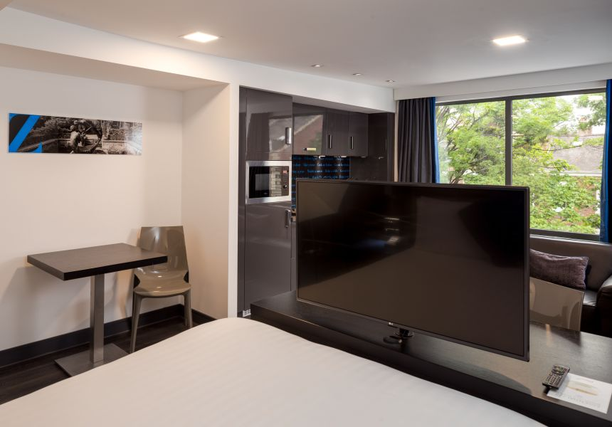 Grande Studio Student Apartment in Chester with large flat screen TV. IconInc @ Roomzzz