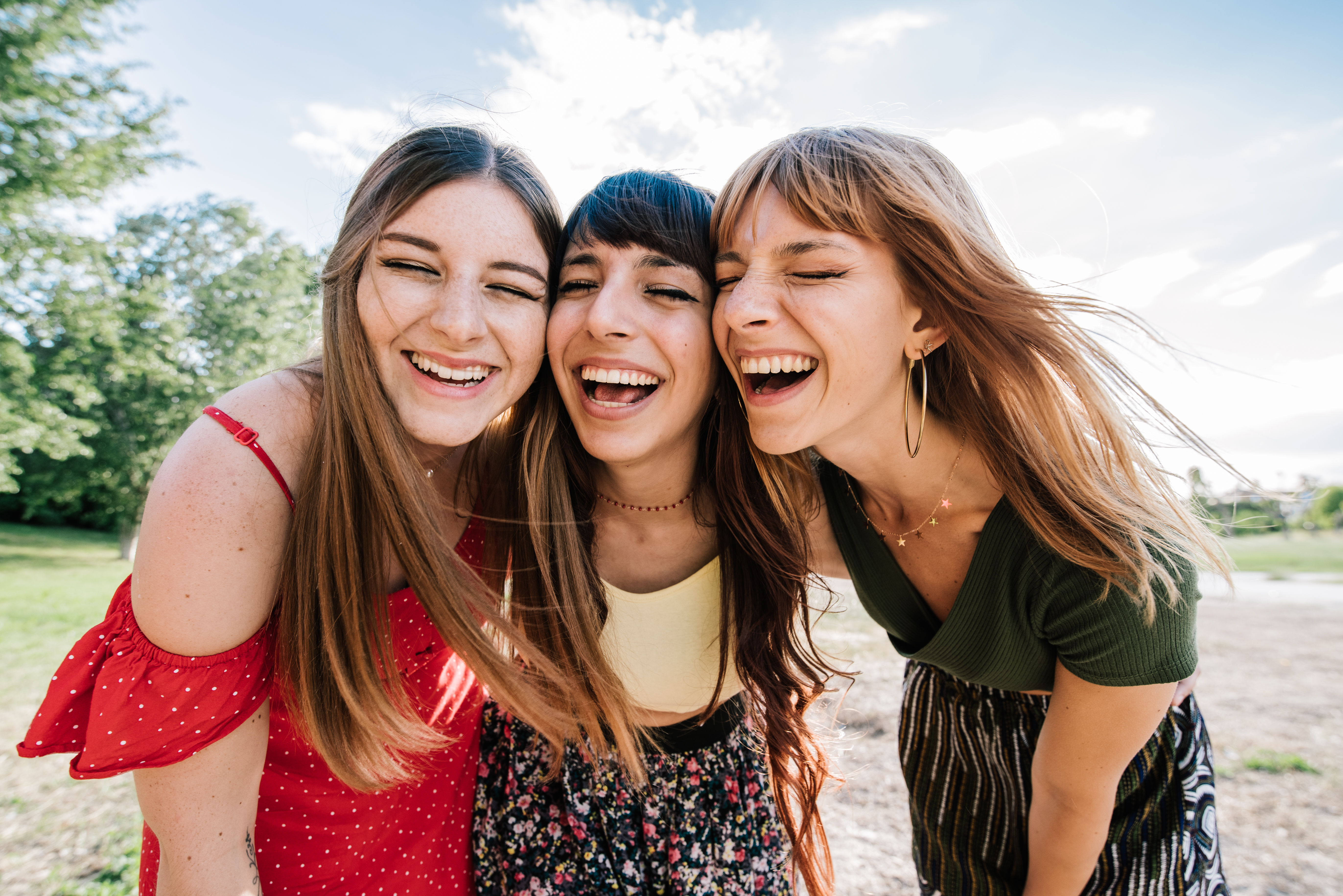 portrait-of-three-young-female-friends-laughing-together.jpg