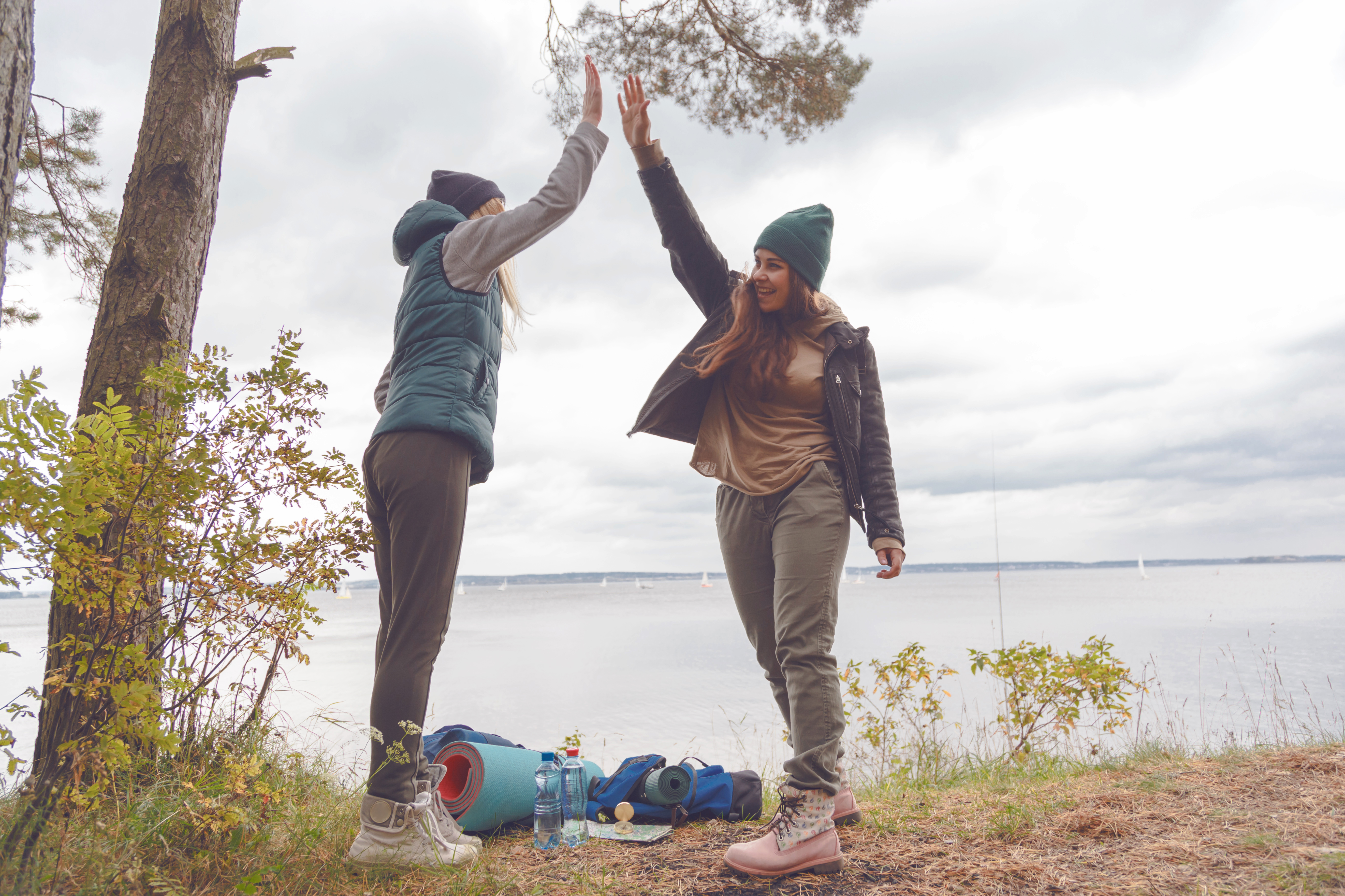 two-girlfriends-travelers-are-proud-of-themselves-and-gave-each-other-high-five.jpg