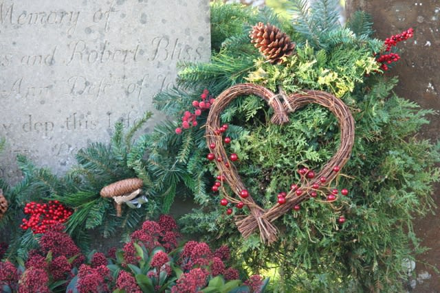 Christmas flowers on grave