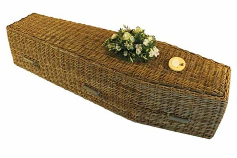 grey wicker coffin