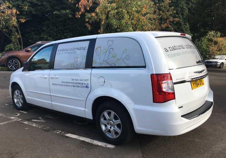 White Chrysler hearse