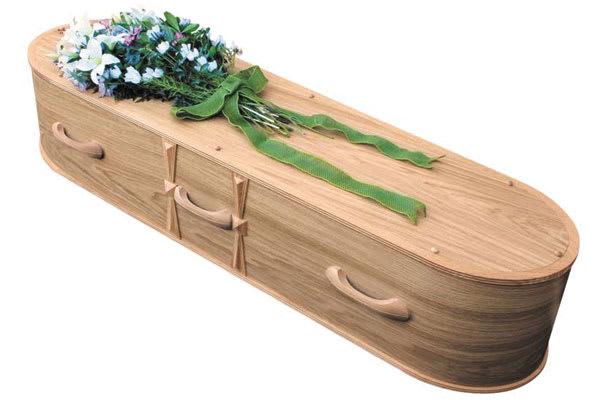 Oval oak veneer coffin