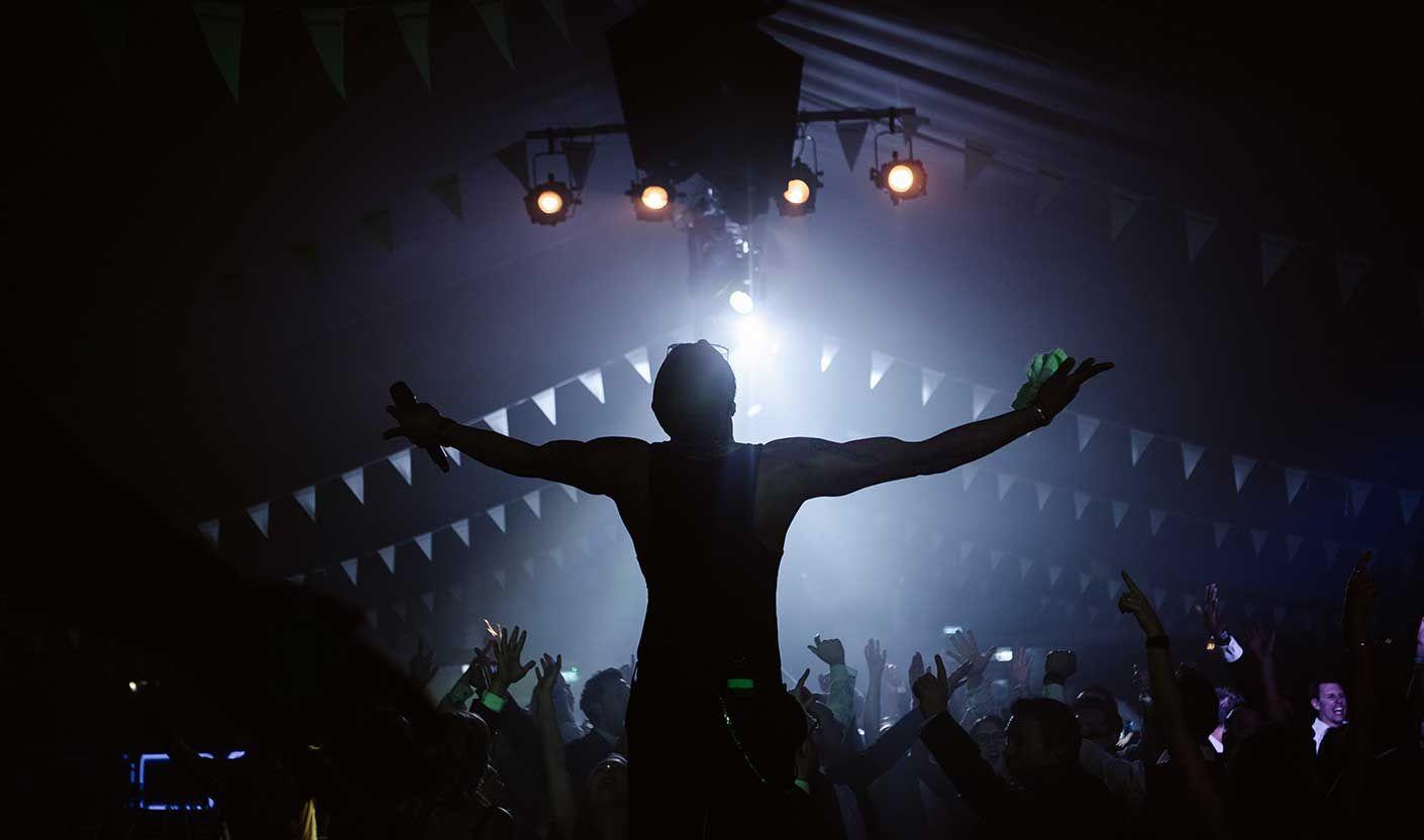 Jam Hot singer silhouette over adoring fans