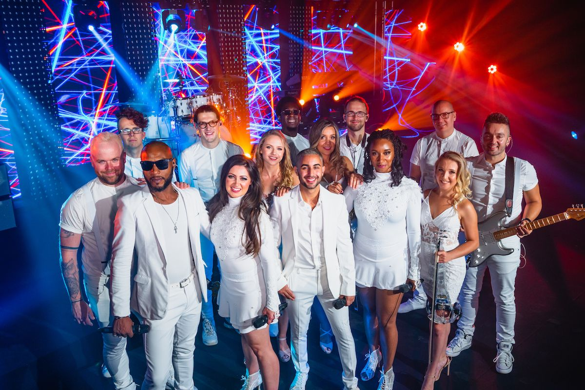 Jam Hot wearing Ice White outfits for a group shot
