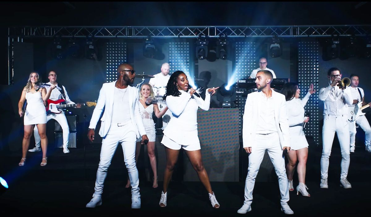 Jam Hot wearing all white perform One Dance
