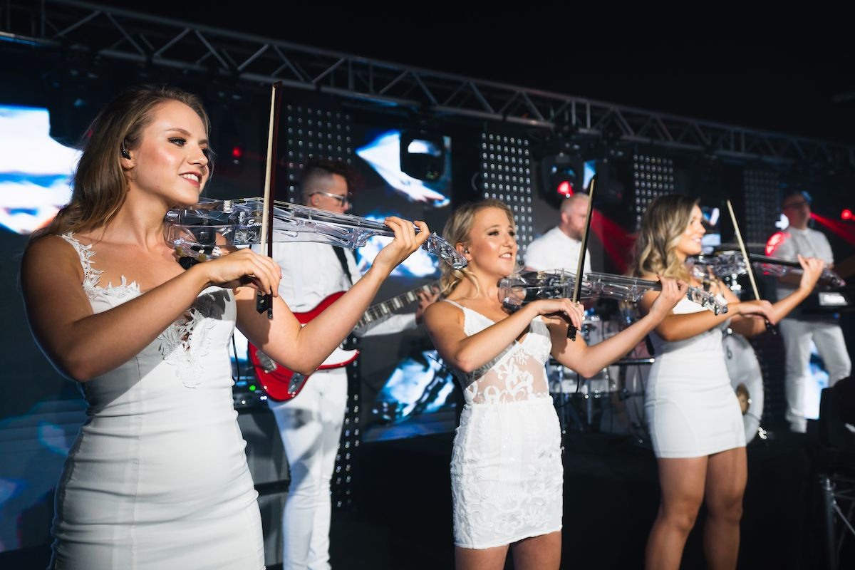 Jam Hot electric string ladies performing in all ice white outfits
