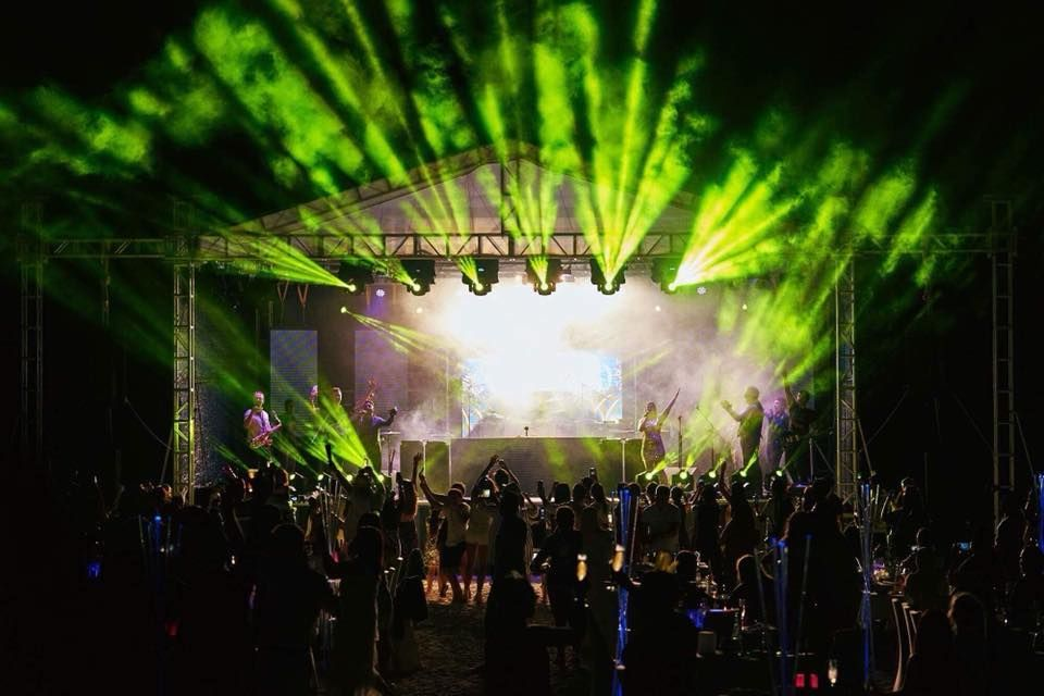 Jam Hot festival stage set up with bright green lighting